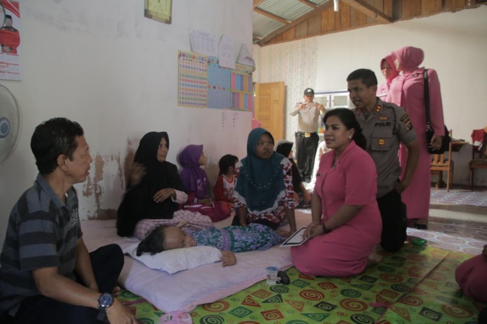 Kapolres Rohul Kunker ke Kecamatan Kepenuhan dan berisantunan Fakir Miskin.