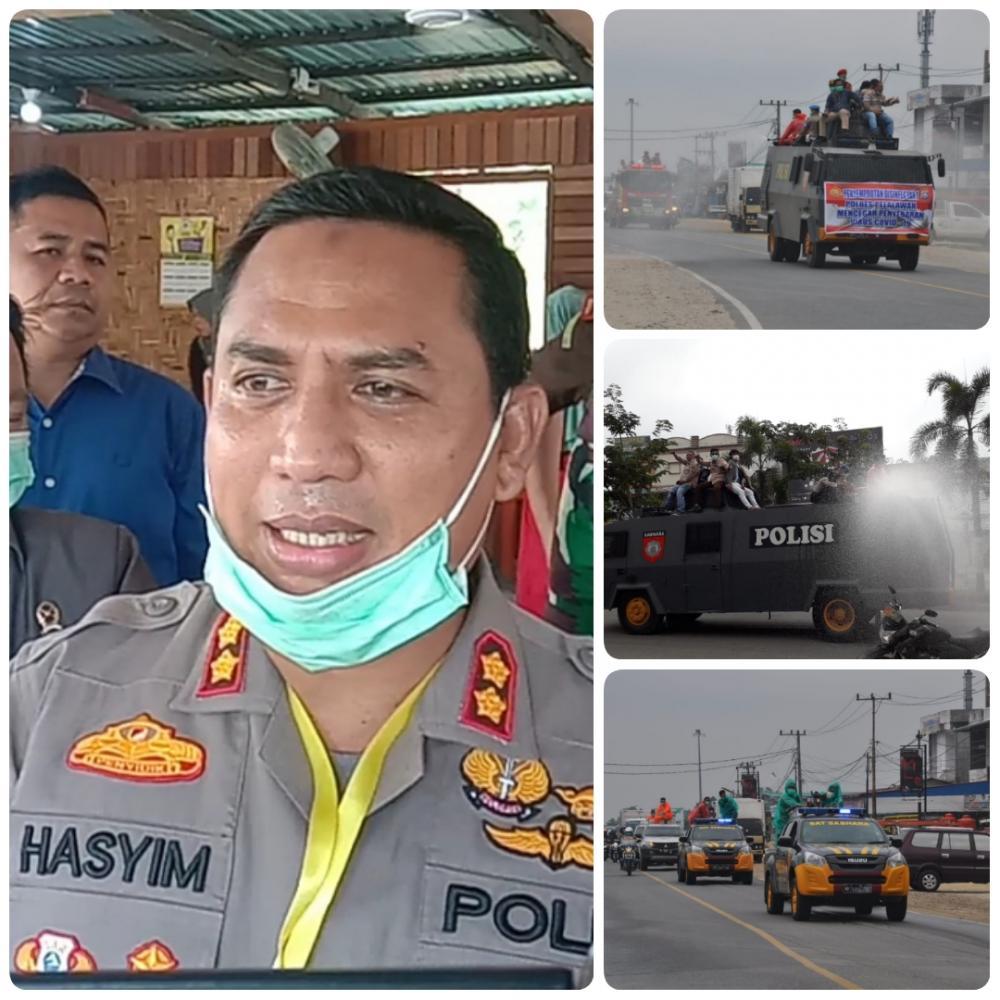 Polres Pelalawan Kerahkan Mobil Water Canon Semprot Disinfektan