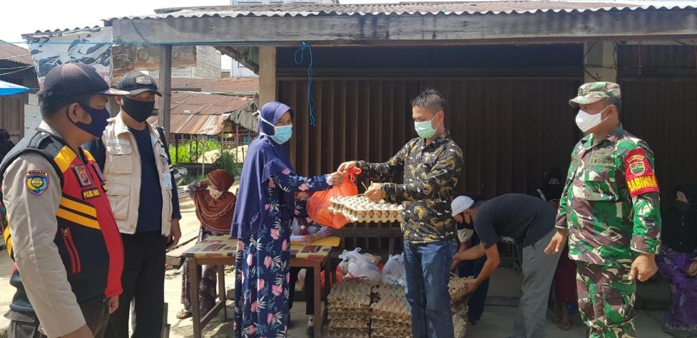 Kepala Desa Belantaraya, Salurkan 250 Paket Sembako Tahap Pertama