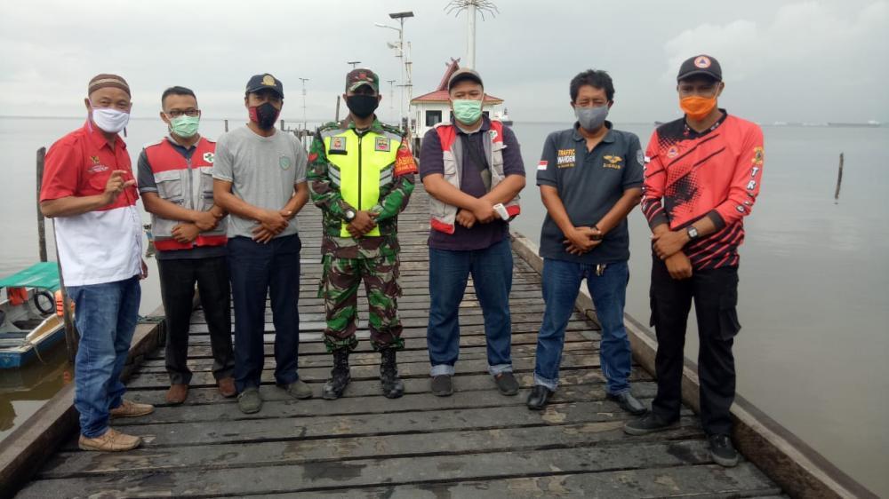Tim Gugus Tugas Kecamatan Rupat Mengadakan Pemeriksaan Suhu Tubuh Penumpang