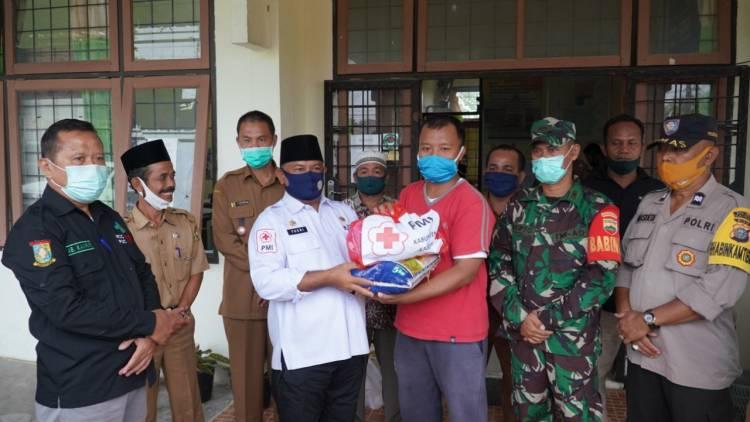Pemkab Kampar Serahkan Bantuan Korban Tertimpa Musibah Jatuhnya Pesawat TNI AU.