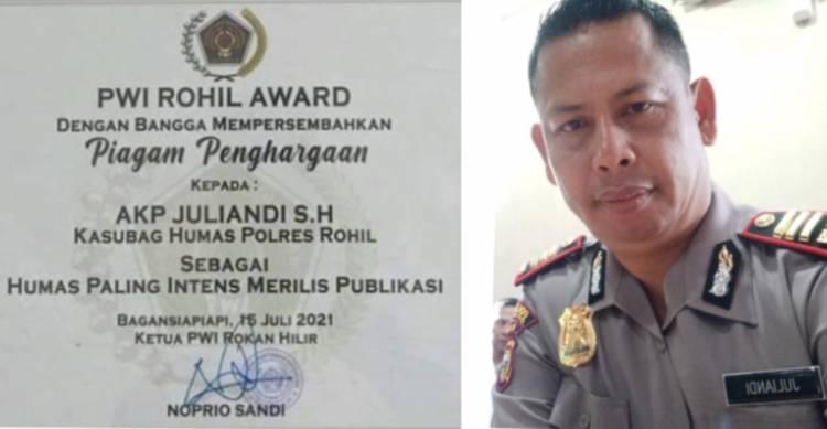 Kasubag Humas Polres Rohil Terima Reward dari PWI
