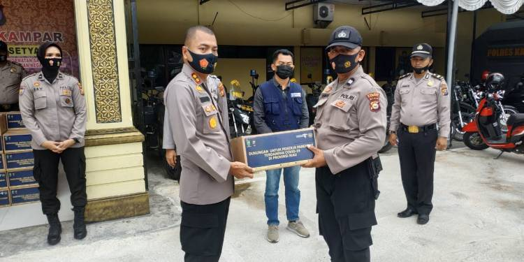 Polres Kampar Distribusikan 455 Paket Sembako dari Kementerian Parawisata RI kepada Masyarakat