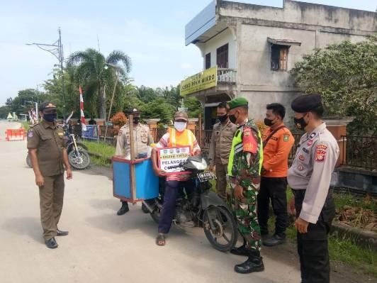 Babinsa Koramil 05/Rupat Gelar Operasi Yustisi di Pos PPKM